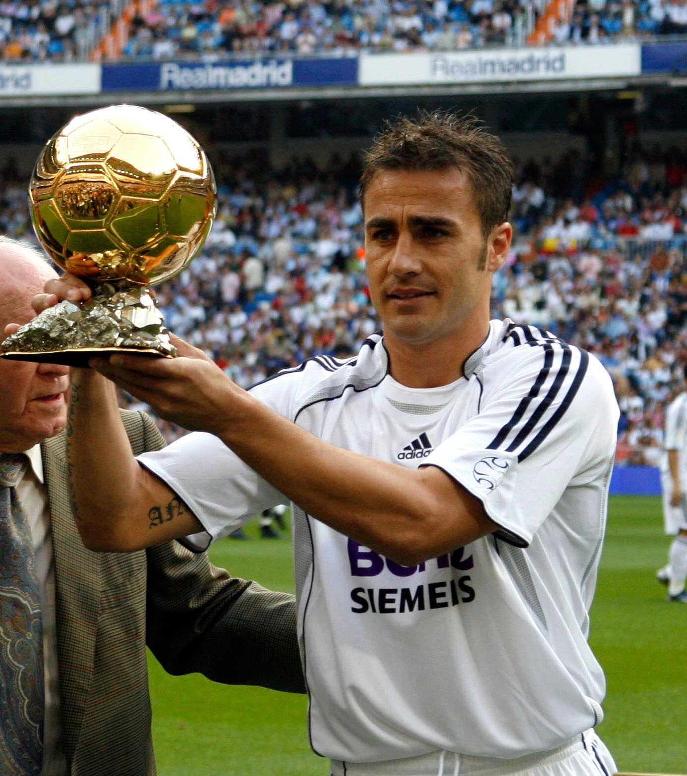 Image result for Cannavaro with the Ballon d'Or after a scintillating year with Italy and Real Madrid in 2006