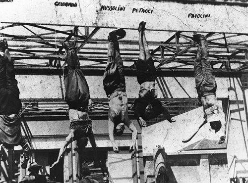 The corpse of Italian fascist leader Benito Mussolini (1883-1945) hanging by his feet  Just punishment!!