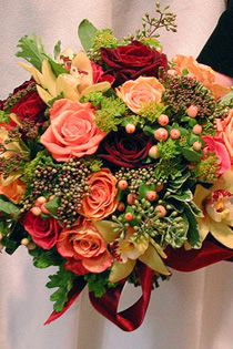 Peachy hypericums and roses, red roses, lime fillers