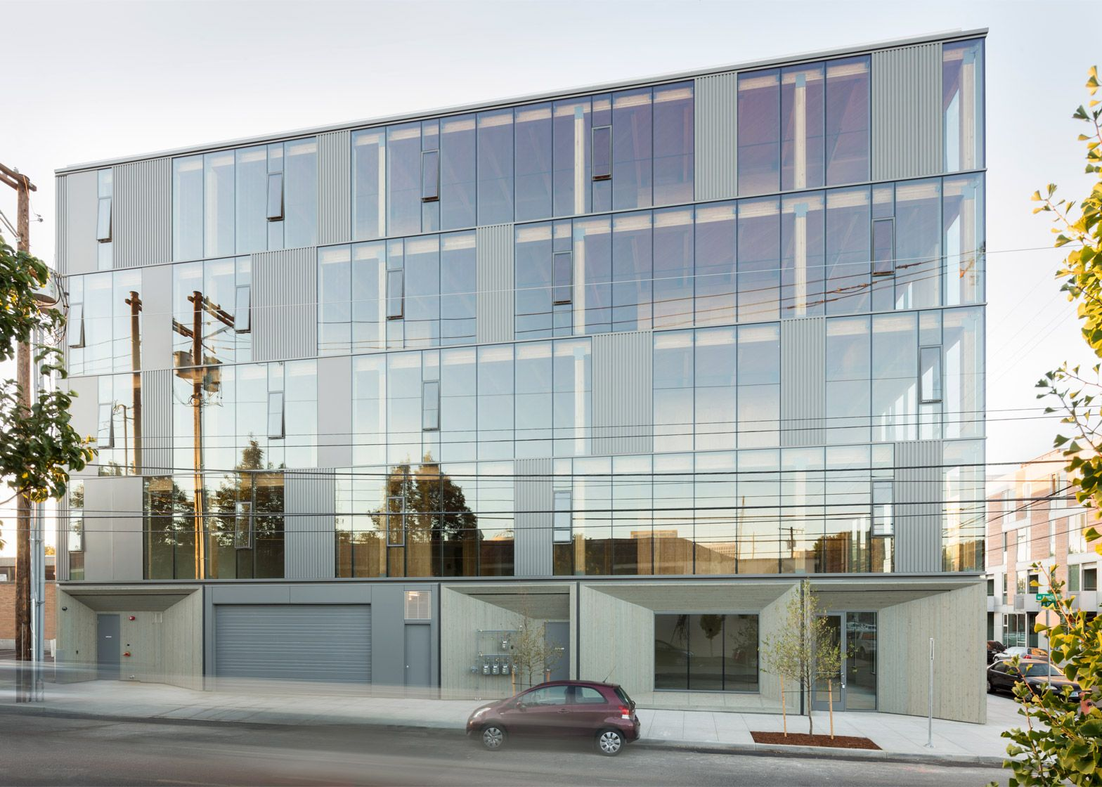 Glass facade reveals timber structure of portland office for Commercial building architect