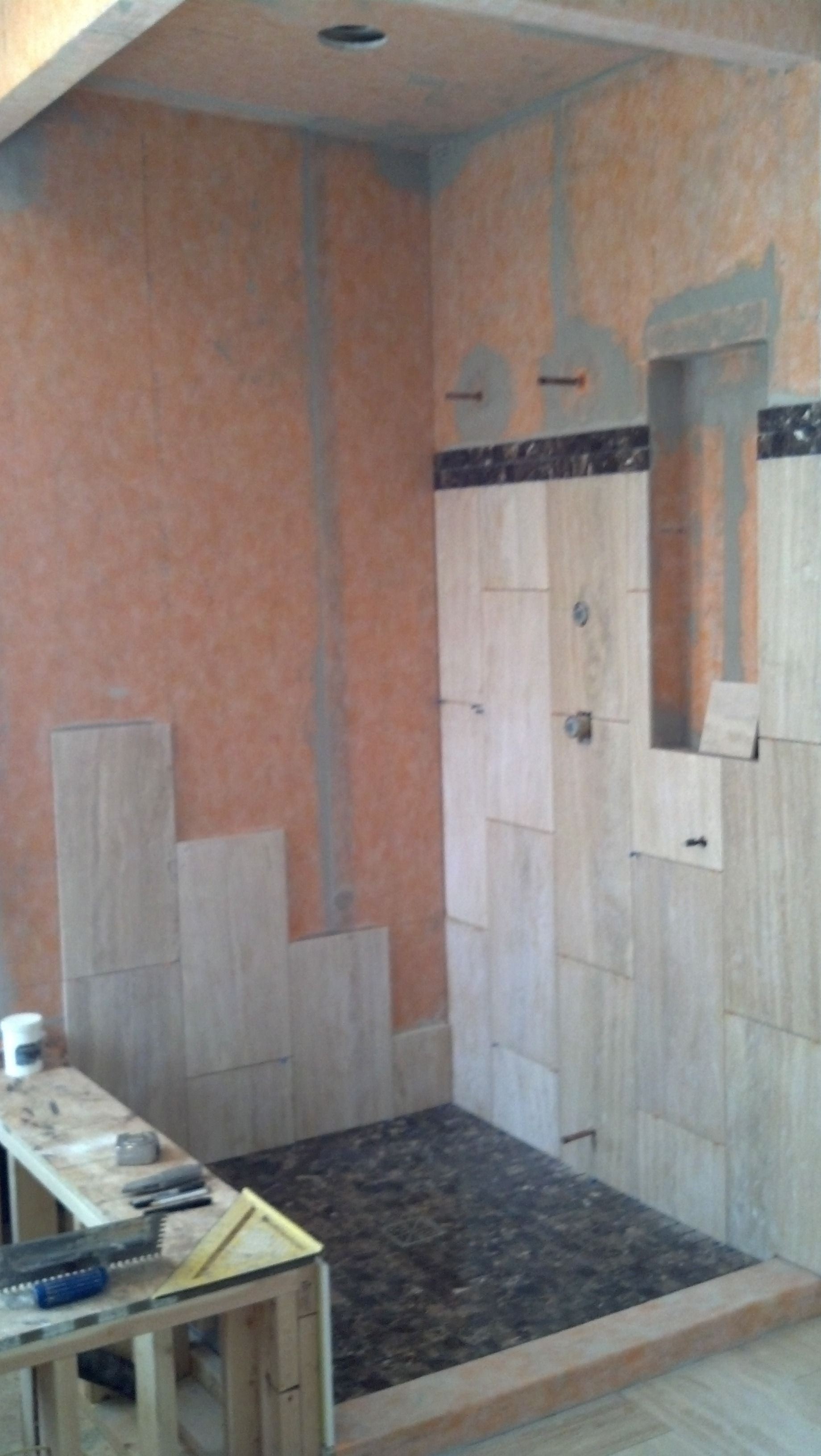 This Shower Is Going To Be A Steam Shower The Orange Color On The Shower Walls Is A Waterproof Vapor Proof Fabric That Gives Us A 10 Bathroom Wall Decor Water Damage