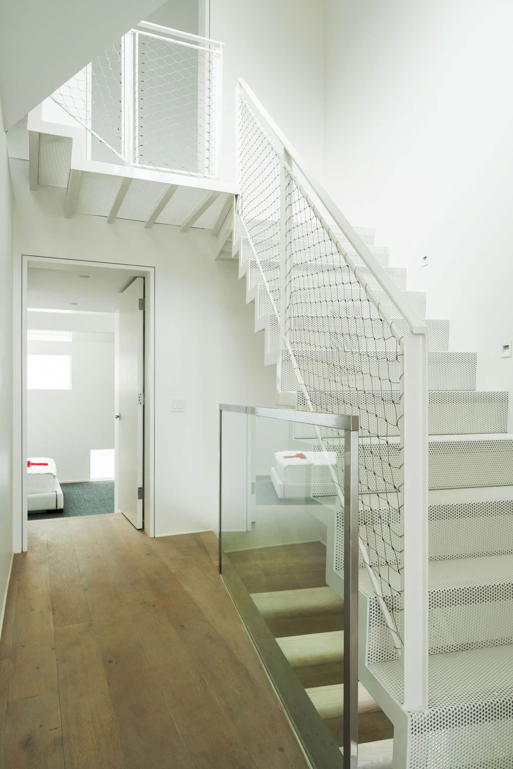 Contemporary Beach House Minimalist White Hallway With Glass Railing And Open Floating Staircase Nonag Contemporary Beach House Beach House Decor Home Decor