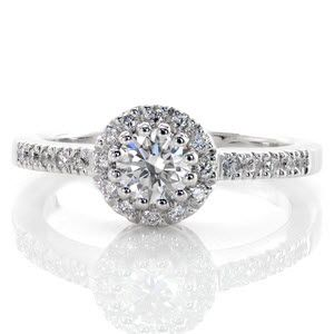 The Classic Halo is a charming design with a unique setting. The 0.50 carat round brilliant cut center diamond is set with twelve prongs to form a decorative circle. http://www.knoxjewelers.biz/products/classic-halo