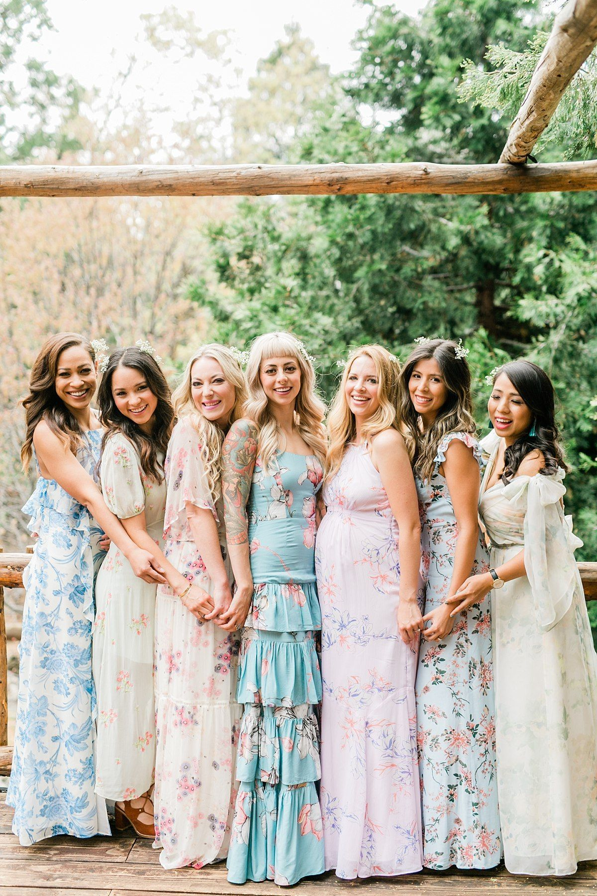 Mix Matched Bridesmaid Dresses In A Variety Of Floral Prints For A Midsummer Nights D Pastel Bridesmaid Dresses Pastel Bridesmaids Patterned Bridesmaid Dresses