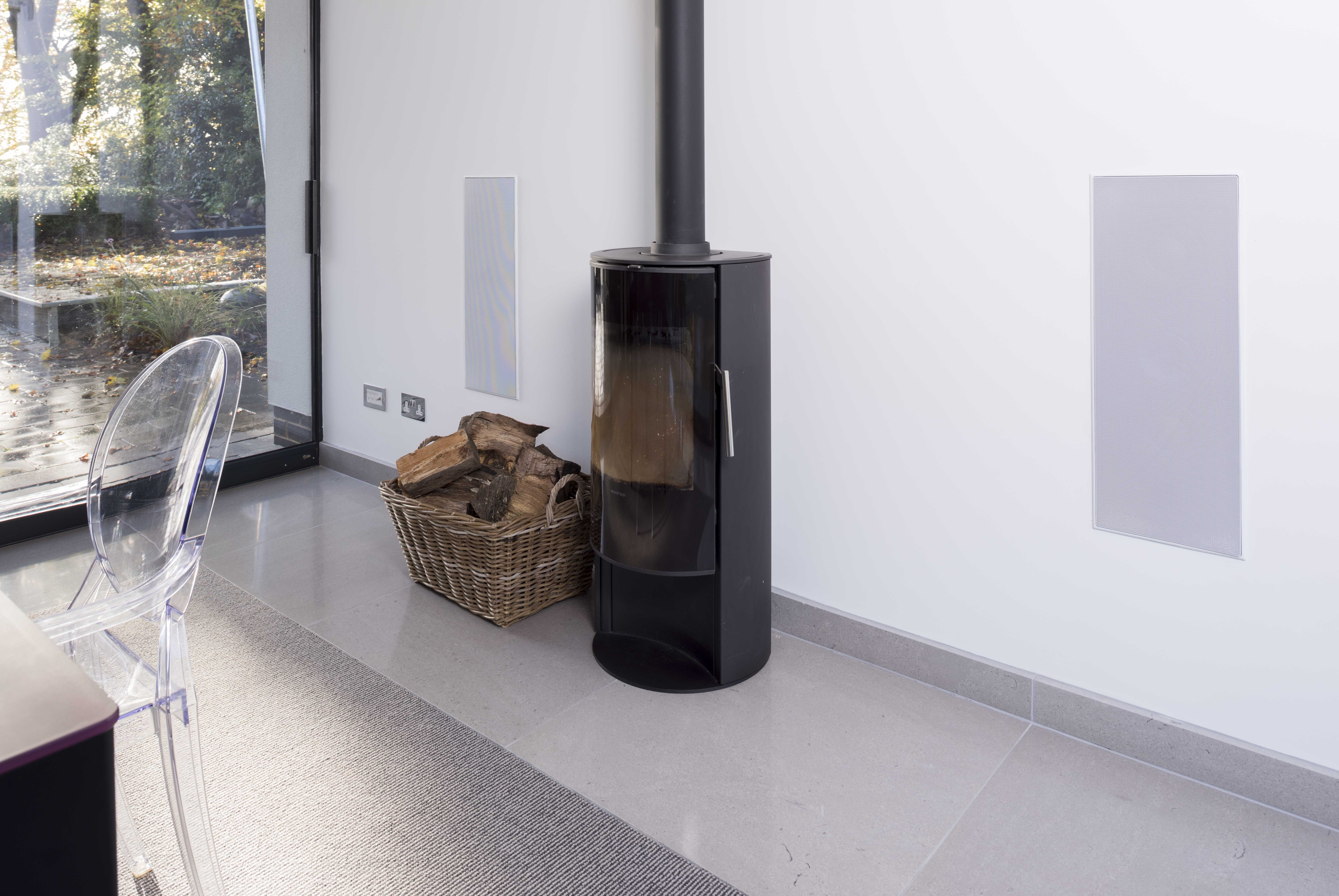 Audio | Bowers and Wilkins in-wall speakers sit either side of log ...