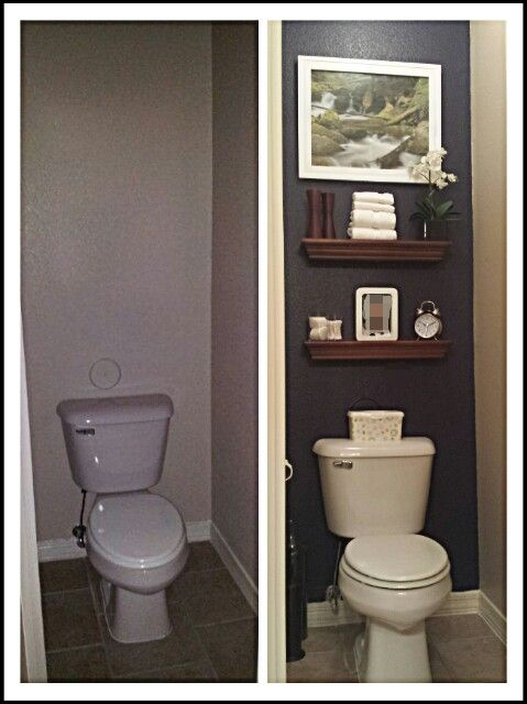 Toilet closet makeover! Painted back wall navy and the rest of the walls a slightly darker shade of khaki/tan than the original color. Added dark brown floating shelves to incorporate my bronze bath accessories. The wall that has the door has about a foot left over on the left side. I placed the trash can there and attached a dark wicker basket on the wall to hold magazines and febreeze bottle.
