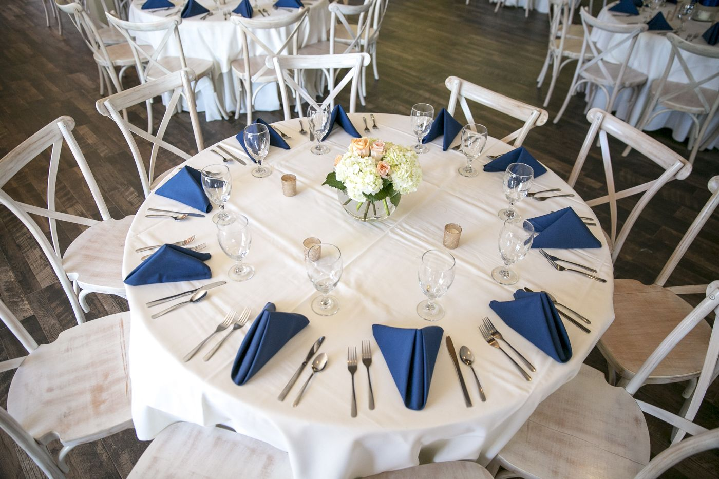 Copper roux reception table complete with navy napkins
