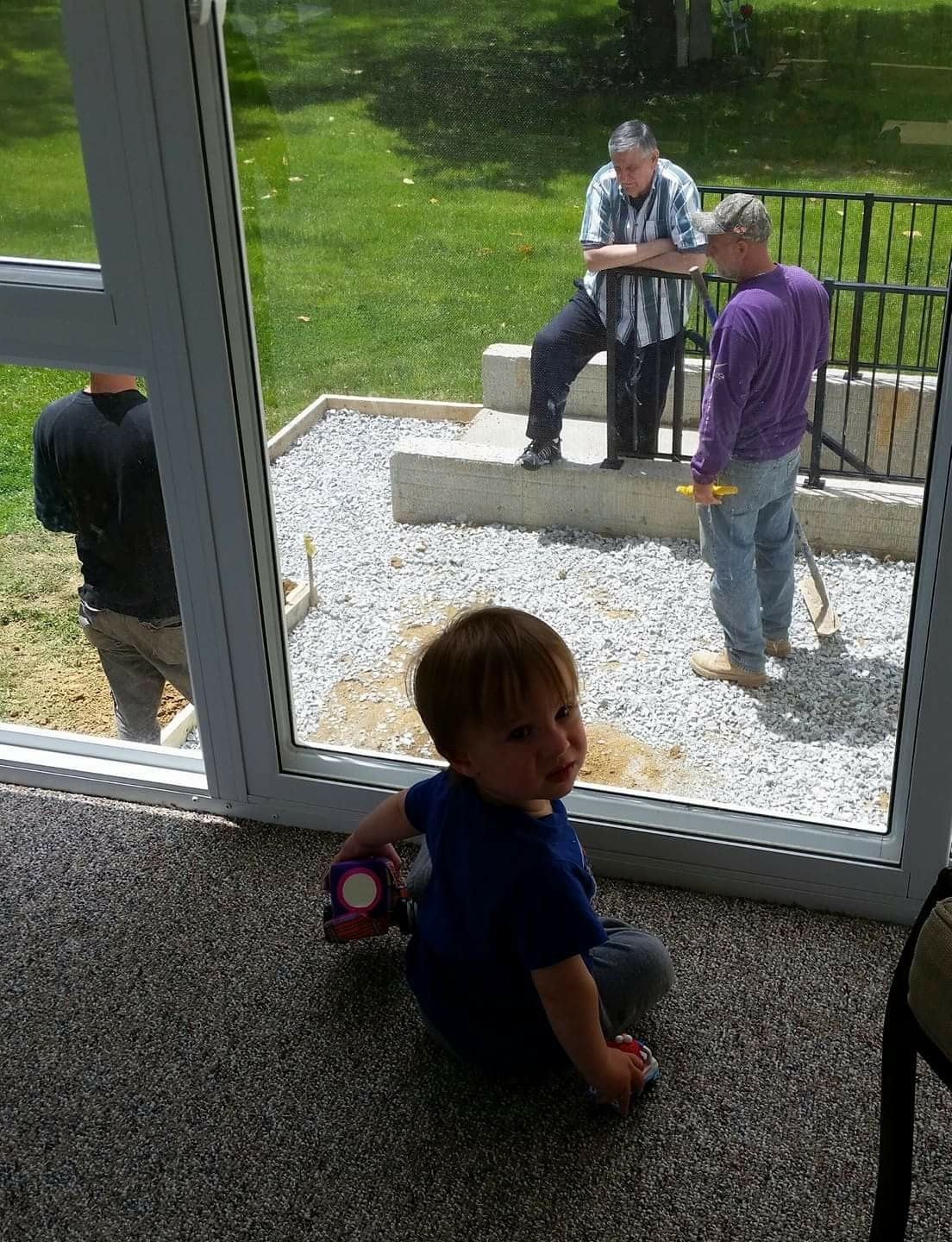 Today Andrew is helping Grampa supervise the patio guys. Looks ...