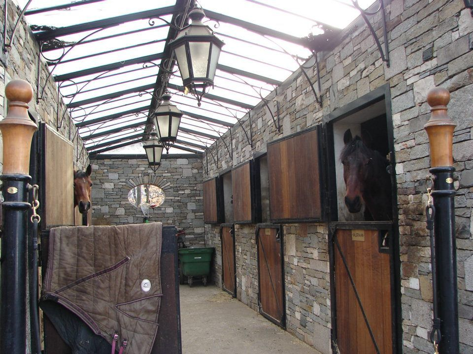 Wowsers barn with stone walls and glass roof i wonder if for Cost of building a horse barn