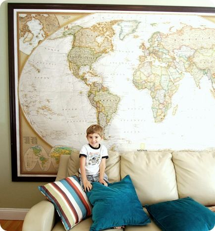 This wall map is from National Geographic and comes in three vertical sections. It's easy to get up on the wall ~ use a staple gun to attach it to the wall and double sided tape to keep the seams together. To create the frame, trim it with MDF chair rail after spray painting it espresso brown.