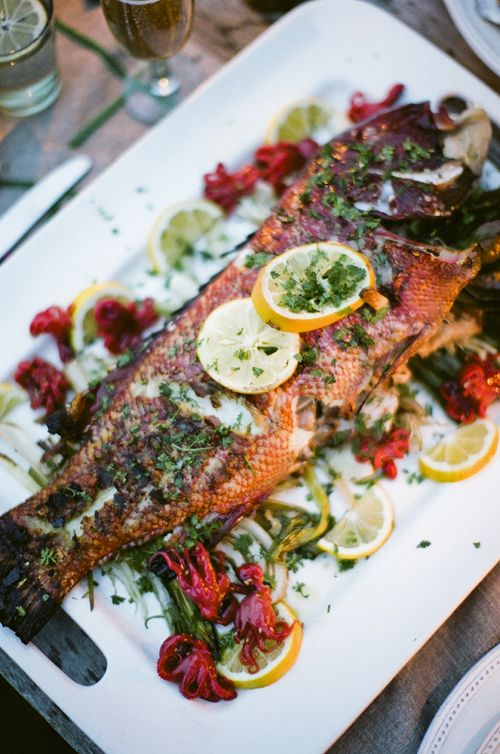 Grilled red Sheepshead fish with olive oil, Maldon salt, garlic, and fresh lemon juice (recipe)