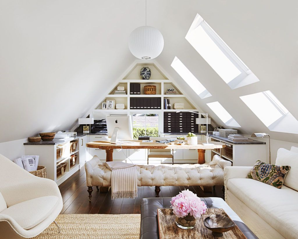 Home office tucked up in this peaked arch room. The sun lights add ...