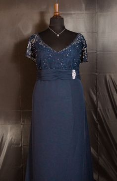 This plus-size mother of the groom dress features lace bodice and ...