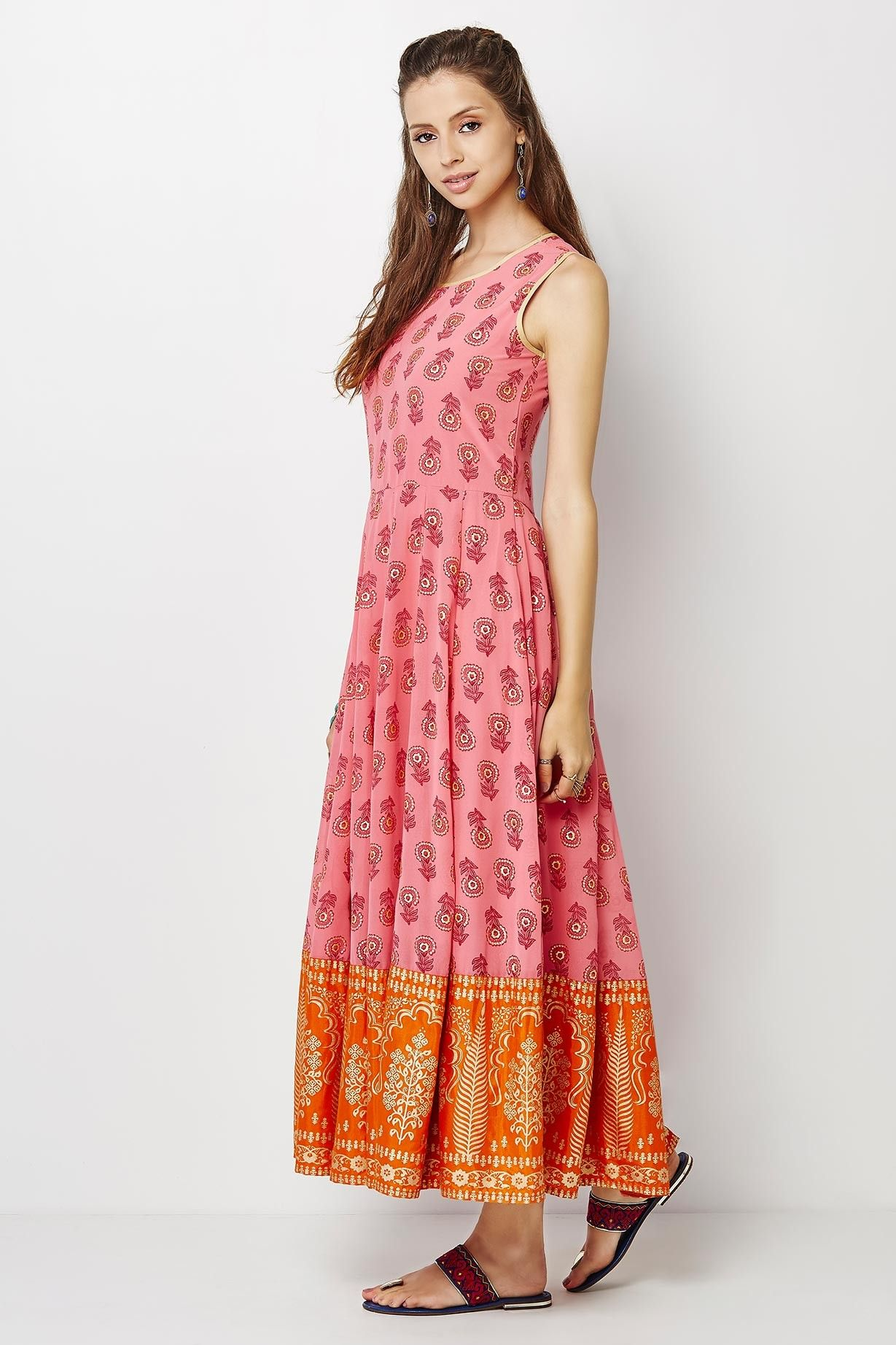 9ca8365e16 A sleeveless, easy flare maxi kurta in a floral print with a gold printed  border.