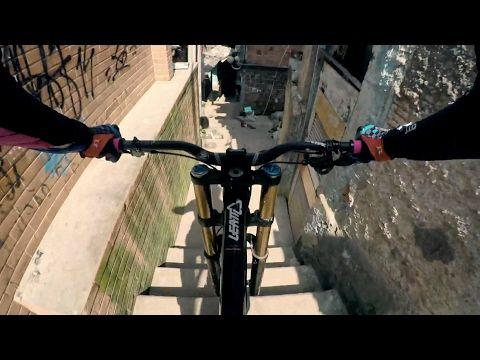 Urban Mountain Biker Rips Through Crowded Rio Favela Video