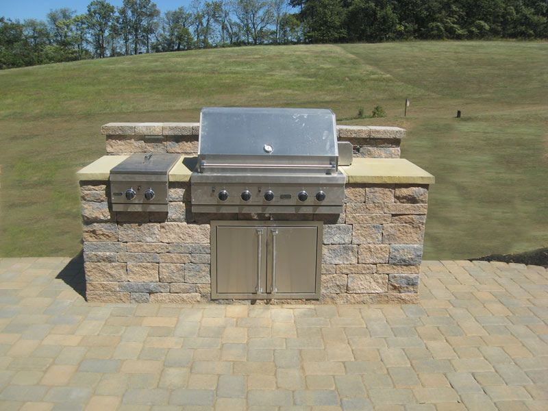Custom made outdoor grill constructed out of techo bloc for Block outdoor kitchen