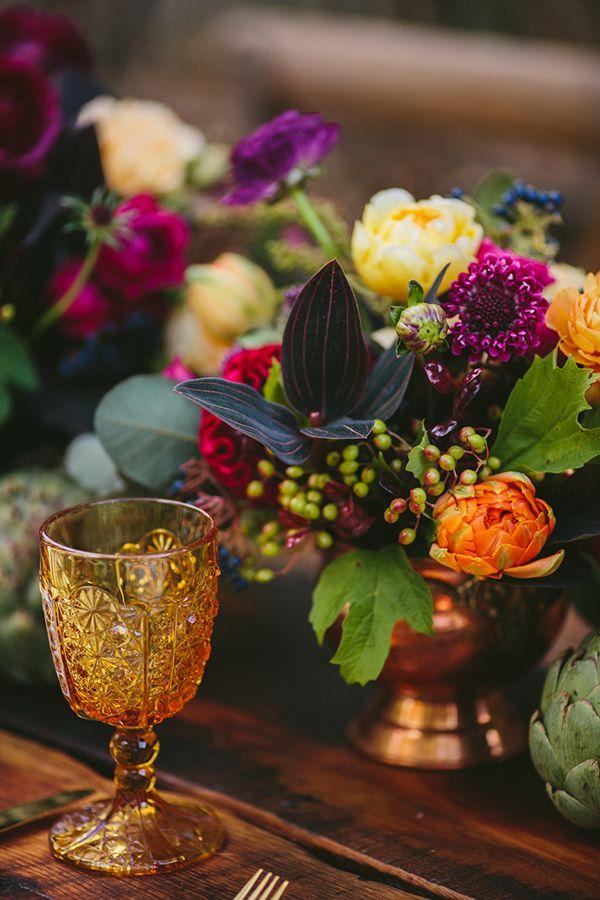orange and purple wedding centerpieces - photo by KMitiska Photography http://ruffledblog.com/summer-harvest-wedding-inspiration