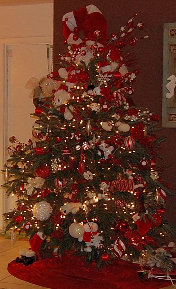 Red and White Christmas tree lots of lights, toys, plush animals
