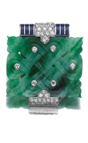 Jadeite, enamel and diamond clip, Cartier, Paris, 1930s. The open work carved jadeite plaque inset with single-cut diamonds, highlighted with blue translucent enamel, signed Cartier and numbered, French assay and partial maker's marks.