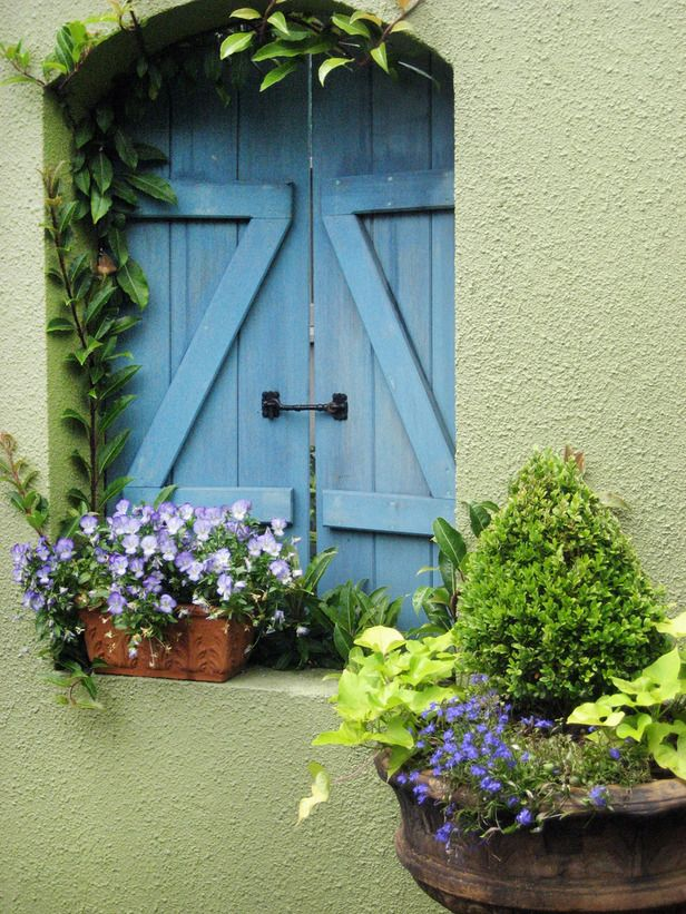 I love green, blue, and purple, so this is my idea of a perfect pair of shutters!