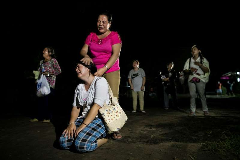 © Paula Bronstein/ Getty Images Wiang Papao, Thailand  Family members mourn the death of two of their daughters as they weep outside of the school dormitory where a fire broke out on Sunday night killing at least 17 girls, May 23, 2016.