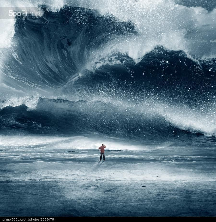Huge Tidal wave with man - stock photo