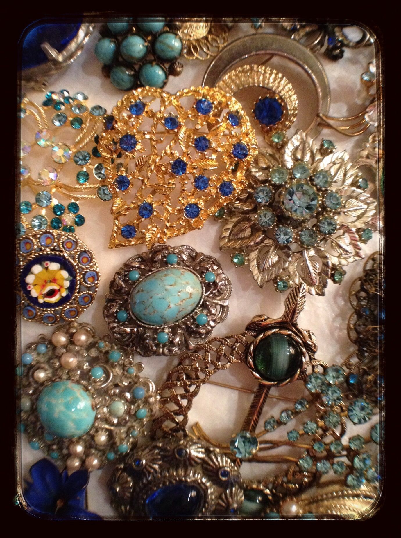 Blue brooches. https://www.facebook.com/pages/The-Jewellery-Cloud/160517894095561