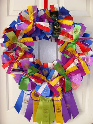 Dog show ribbons have been made into a door wreath   Dogs