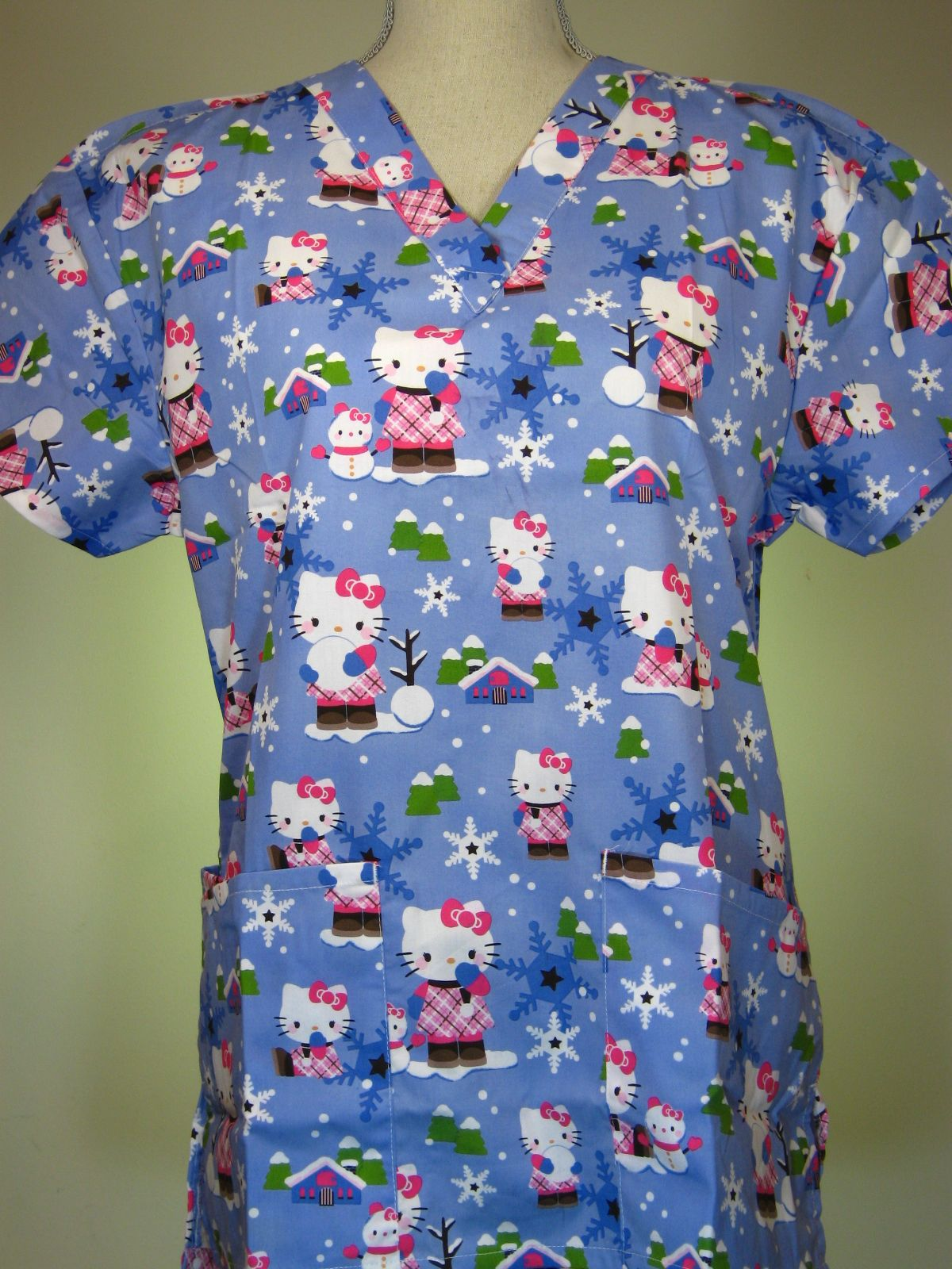 6f8d6a3fd8c #caringplus scrub top - Hello Kitty Winter Snowflakes Blue - CaringPlus  scrubs and uniforms - workwear clothing for nurses, caregivers and other  healthcare ...