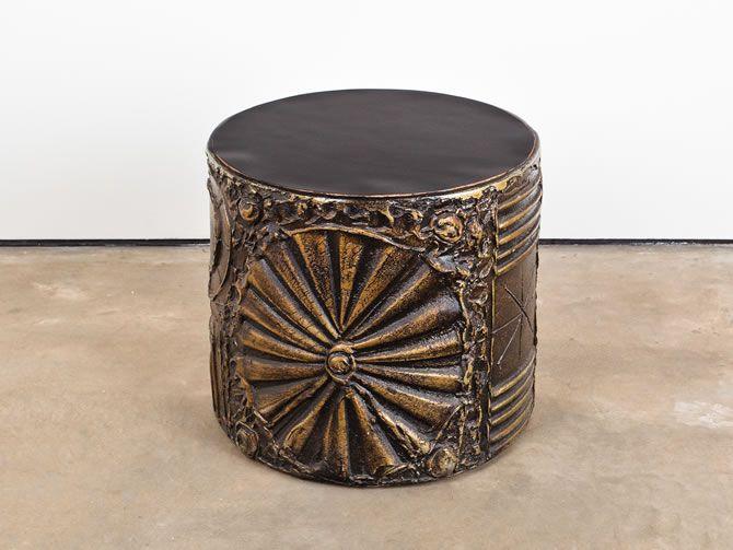 This Round Brutalist Style Side Table With Black Laminate