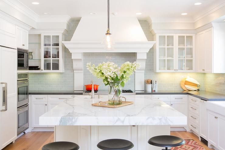 U Shaped Kitchen Features White Shaker Cabinets Paired