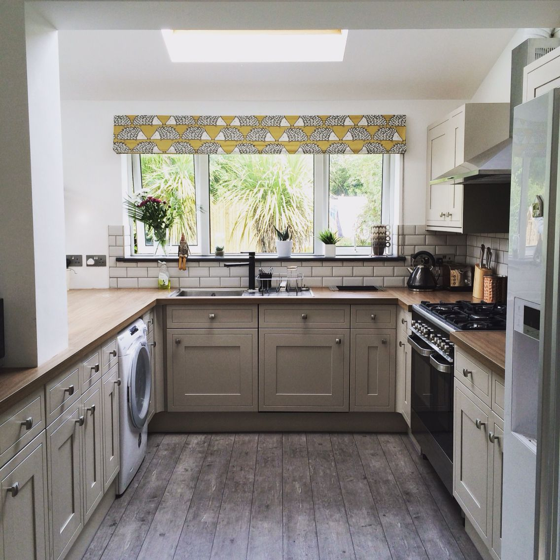 Tewkesbury Stone Kitchen With Yellow Blinds, Wooden Floor