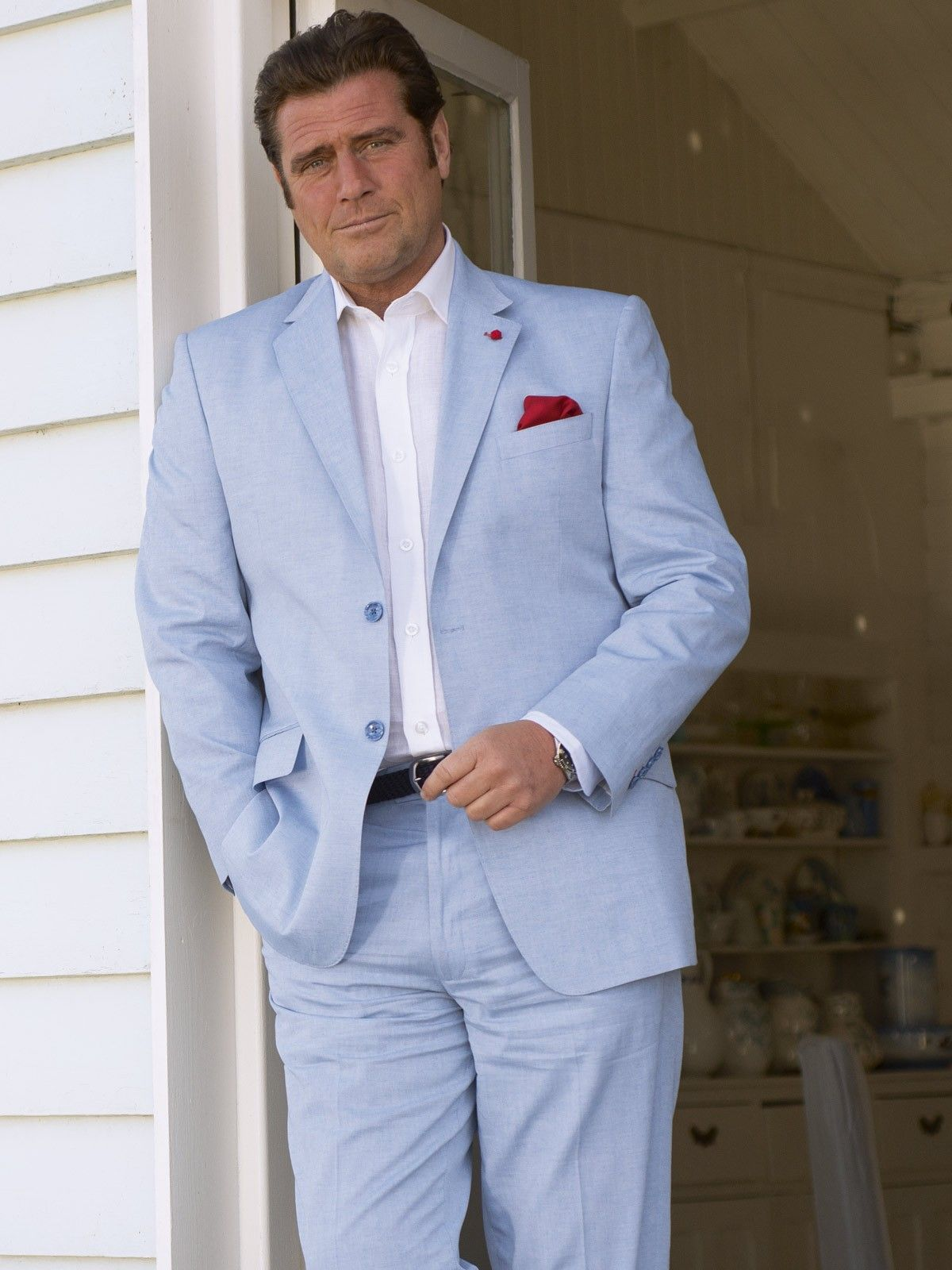 09e6aeb08b6 100% cotton linen suit in Sky Blue. As light as a linen suit but with  sharper lines for a smarter finish. The jacket is fully lined with colour  matched ...