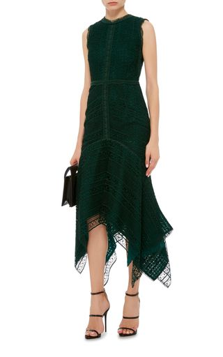 This sleeveless **Costarellos** dress is rendered in guipure lace and features a fluted silhouette with a rounded neckline and a midi length skirt with a handkerchief hem.