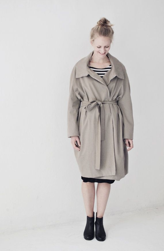 soft and elegant trenchcoat made of high quality cotton fabric from italy. wide cut make this piece a good match for different occasions. pure style