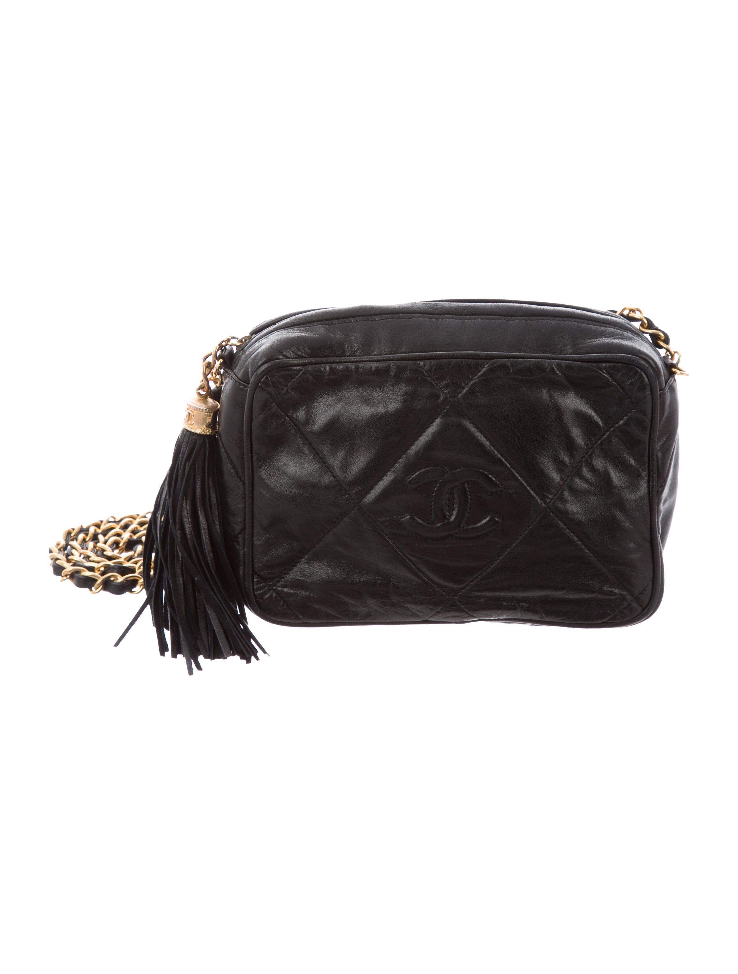 8a084b37e0e8 Black quilted lambskin Chanel vintage small camera bag with gold-tone  hardware