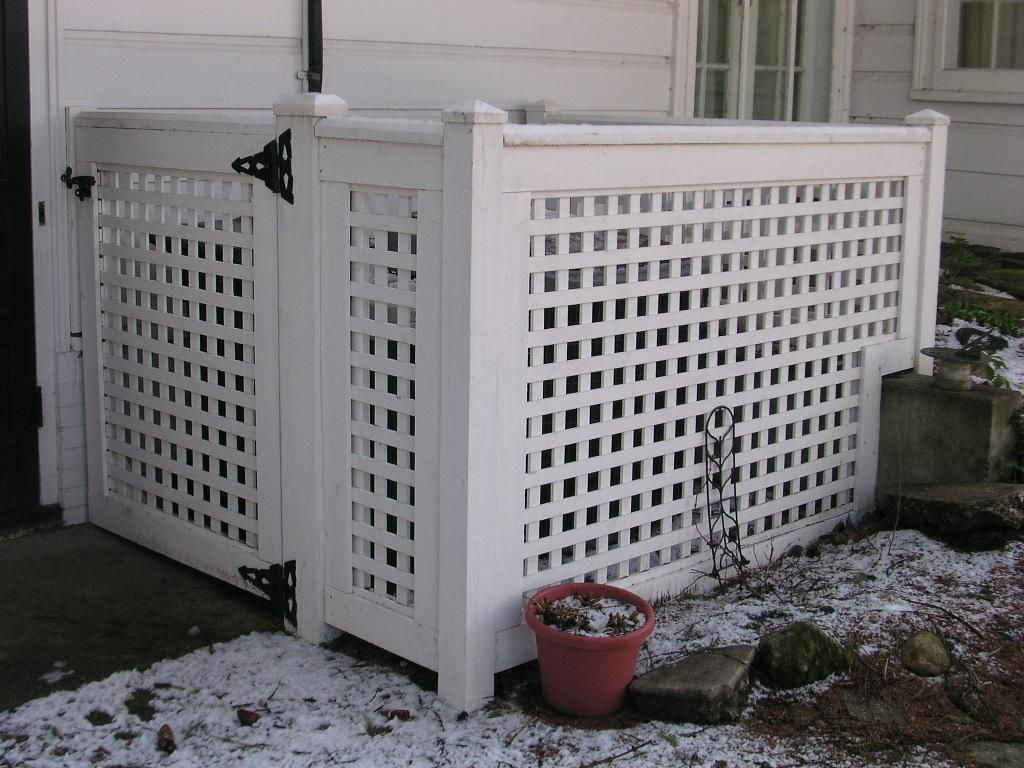 White Wood Lattice Panels To Hide The Garbage Cans