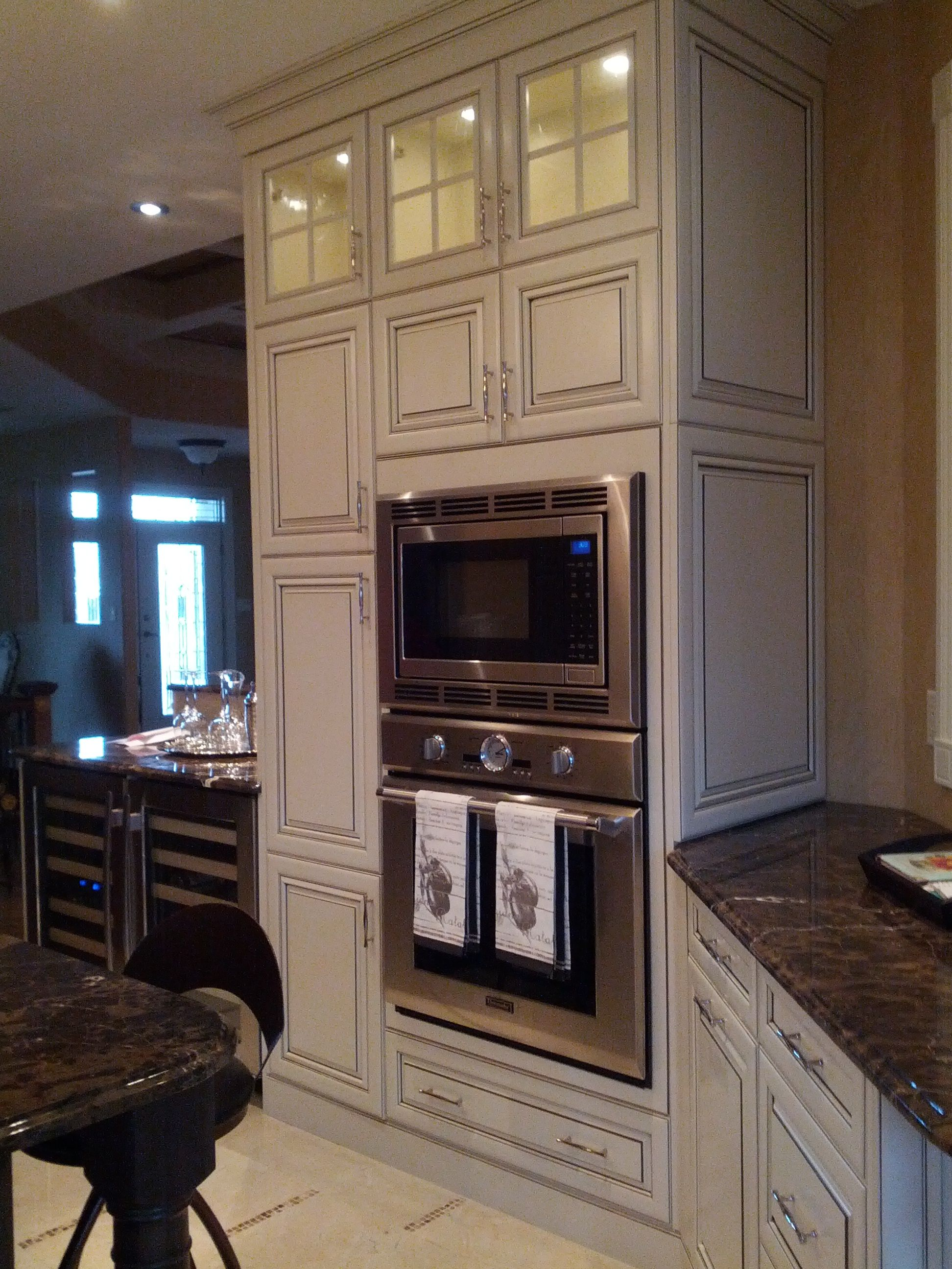 Cabinetry: Kitchen Craft Door Style: Paxson Color: Seashell W/ Smoke Glaze  Species