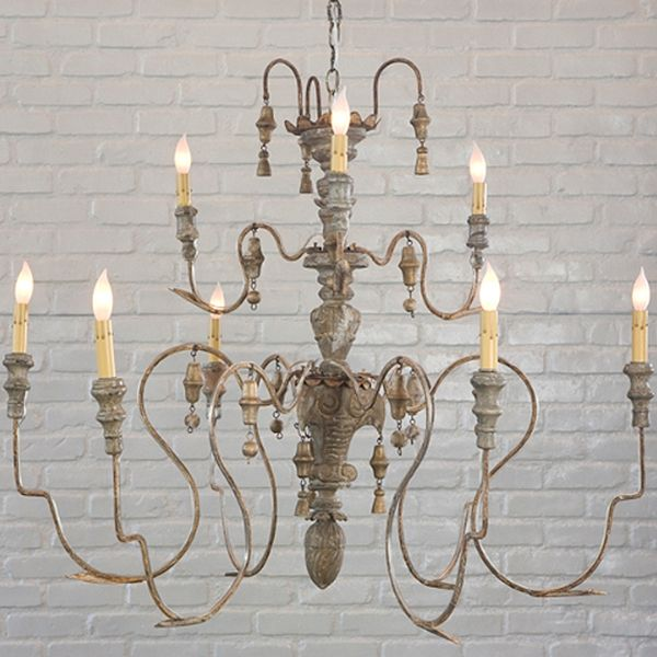 The manoir a rustic french inspired chandelier uses wood and metal the manoir a rustic french inspired chandelier uses wood and metal to create a aloadofball Image collections