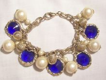 Pretty Loaded Charm Bracelet with simulated dangling Pearls, art beads and Sapphire color glass rivoli rhinestones