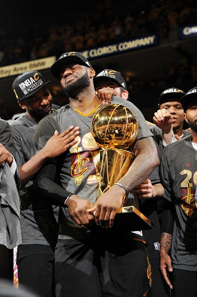 LeBron James of the Cleveland Cavaliers celebrates with the Larry O Brien  NBA Championship Trophy after winning Game Seven of the 2016 NBA Finals. bf47fcc61