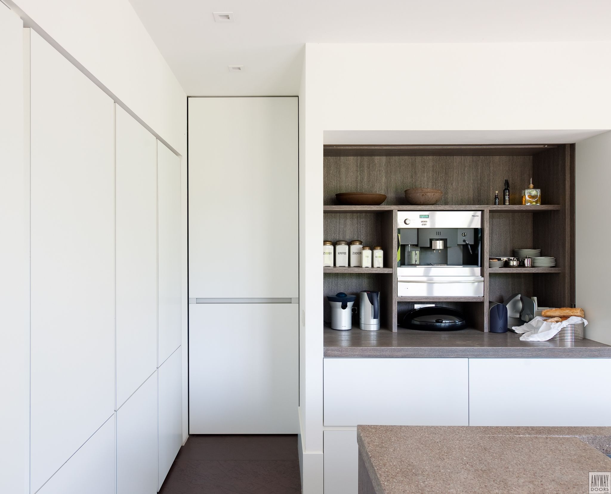 Contemporary Kitchen Design With A Minimalist Interior Door With Invisible