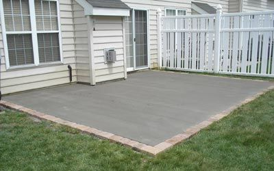 Concrete Patio Design Ideas cool blue Newly Poured Concrete Patio With Ep Henry Paver Border