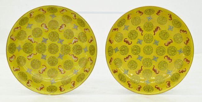Lot 209- Pair of Chinese Xuantong Famille Jaune Bowls 2''x8.75'' Each. Finely enameled with gilt shou symbols, red bats, and blue rolling log motifs. Verso has ducai five color enameling of blossoming lotus and peony flowers. Each bears a red enameled six character Xuantong mark. Excellent, original condition. Xuantong period (1909-11), Qing dynasty. Purchased in San Francisco in the 1960's.