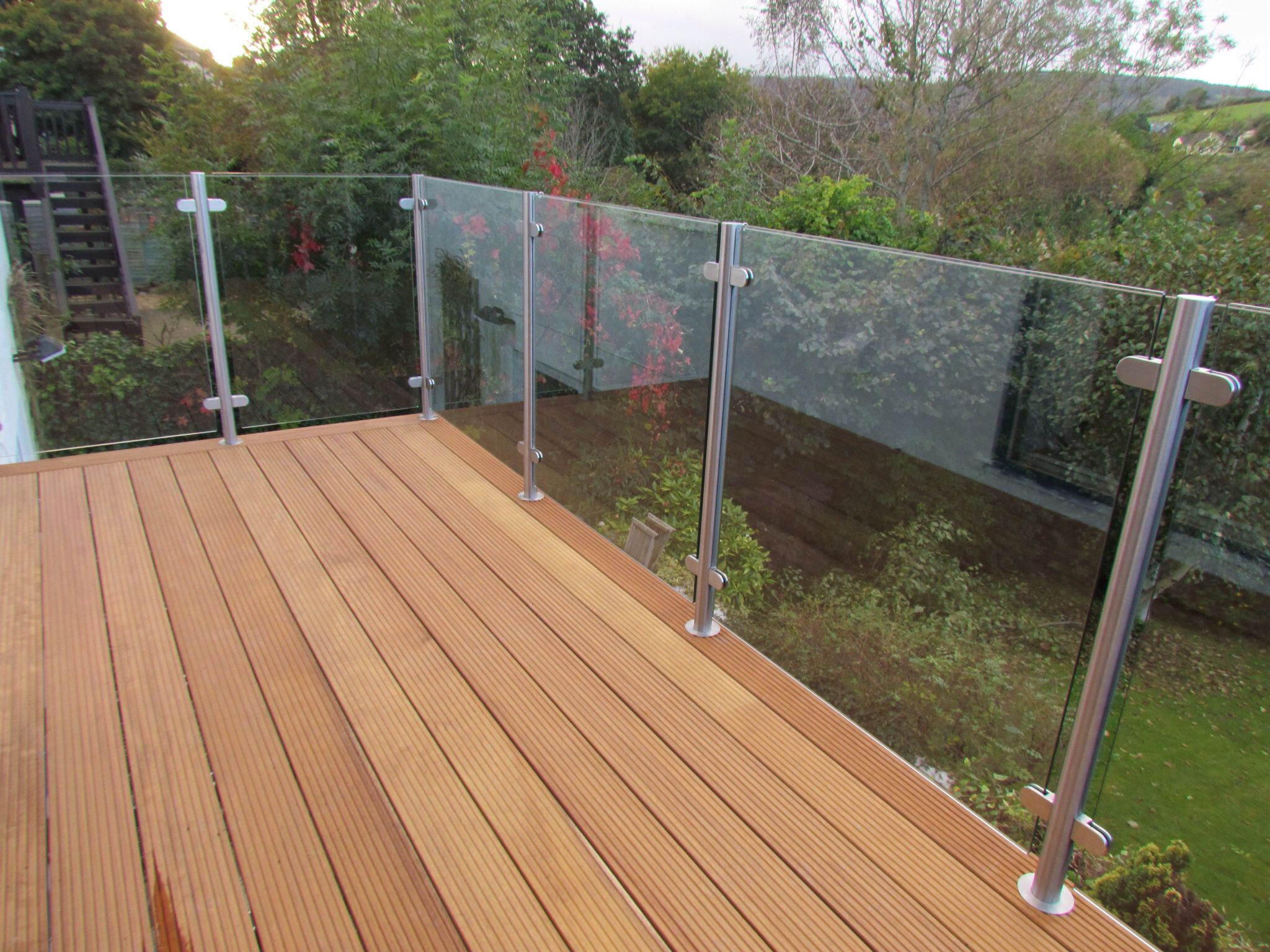 Wooden deck with glass balustrade balcony pinterest for Garden decking glass panels