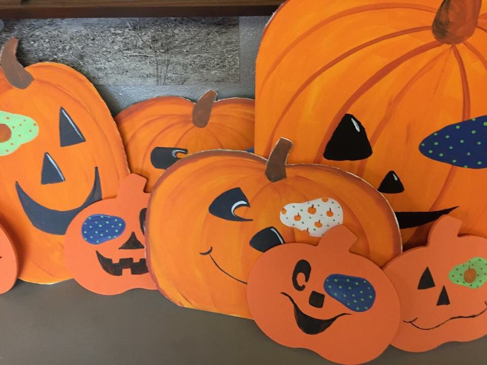 """Make a """"Pumpkin Patch"""" decorate pumpkins with patches and take a picture of your little one amongst them."""