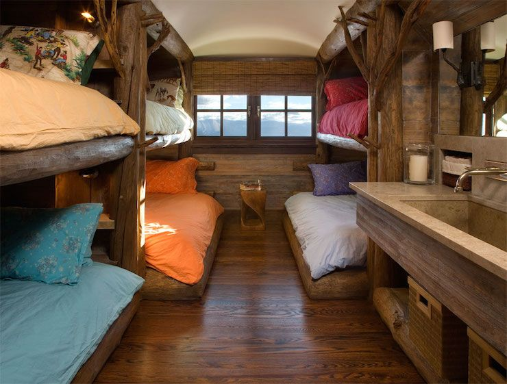 Kids Bedroom Tree House cabin kids' room features built-in, treehouse bunk beds dressed in