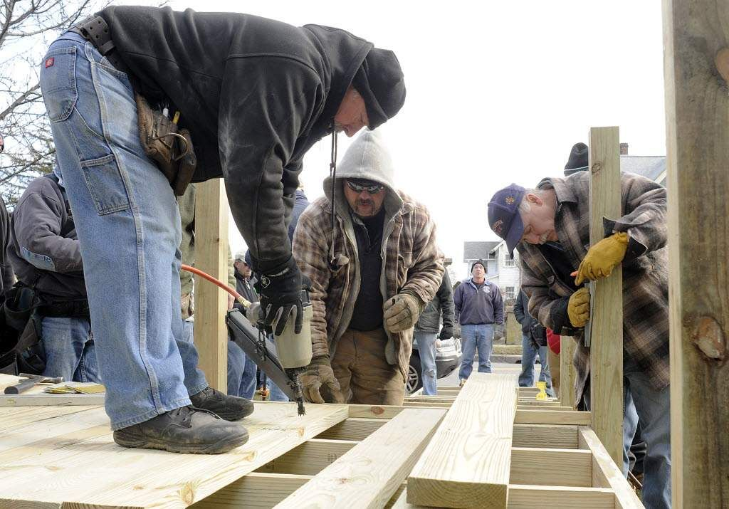 Firefighters build ramp for retired colleague