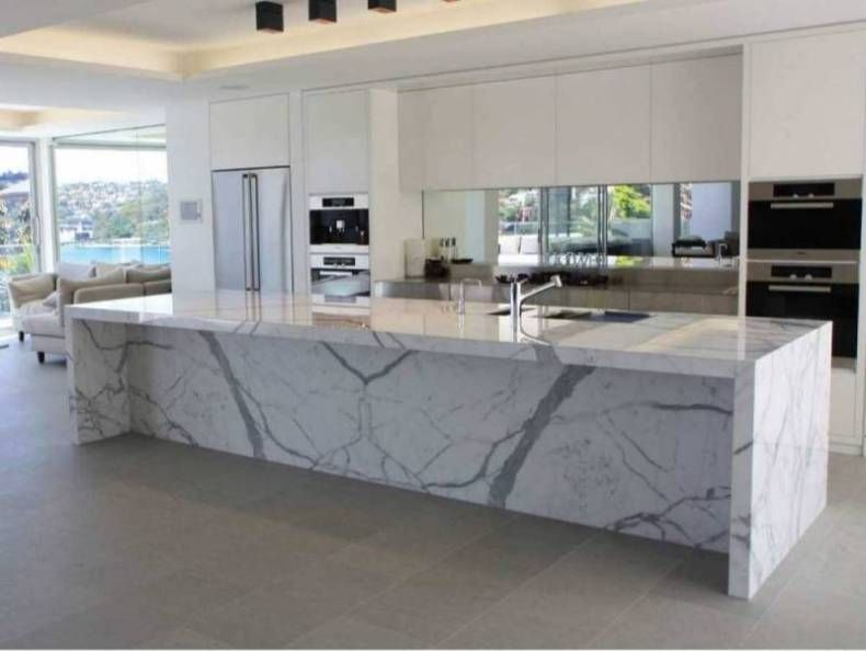 calcutta marble countertops in a modern white kitchen - Marble Kitchen Design