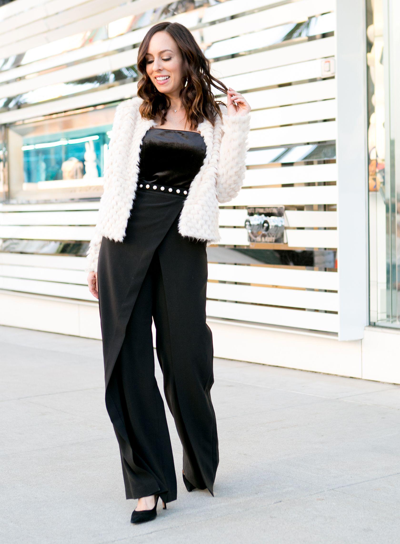 b8b5f5fae78c White fuzzy jacket and black jumpsuit.